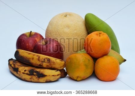 Variety Of Indian Asian Fruits Muskmelon, Oranges, Mango, Banana And Apple. Heap Of Fruits From Indi