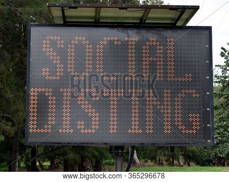 An Illuminated Sign Warning Of Social Distancing In The Mareeba Area Of The Tablelands