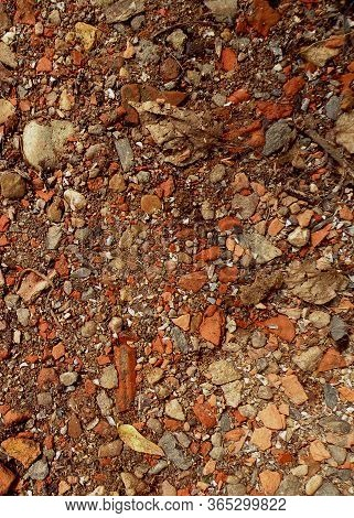 Red Granite Fine Gravel, Stone Background With Red Pebbles. Stone Texture. Top View Of Ground Decor