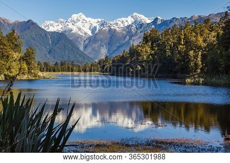 Southern Alps. Matheson Lake - Mirror Lake. Mount Cook And Mount Tasman. South Island. New Zealand.