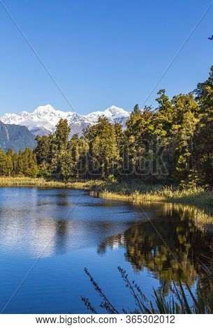 Matheson Lake - Mirror Lake Of South Island. Southern Alps. New Zealand