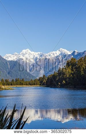 Matheson Lake. Mount Cook And Mount Tasman Reflection. Southern Alps. South Island. New Zealand.