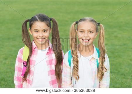 September. Vacation Is Over. Back To School. Cute Schoolgirls With Long Ponytails. Ending Of School
