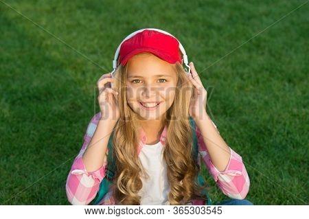 Listen Music While Relaxing Outdoors. Girl Headphones Listening Music. Educational Podcast. Enjoy Ev