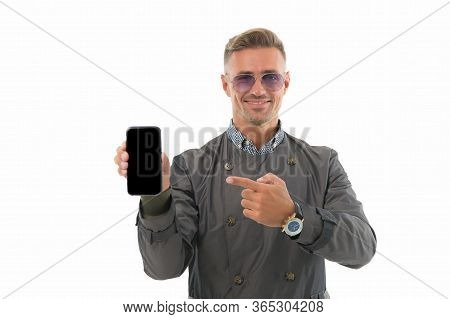 Do You Like This Phone. Businessman Point Finger At Mobile Phone. Handsome Man Hold Phone Isolated O