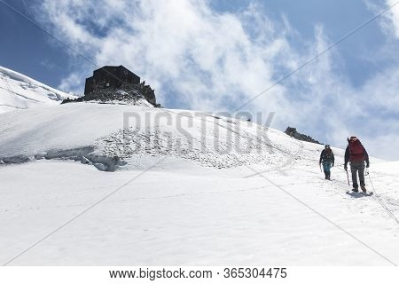 Alpinists Ascend To The Cosmique Refuge Past Col Du Midi In The French Alps, Chamonix Mont-blanc, Fr