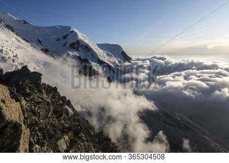 Clouds And Fog Near Dome Du Gouter And Bosson Glacier Mont Blanc Massif In The French Alps. View Fro