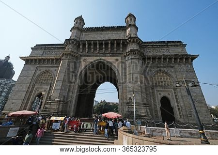 MUMBAI, INDIA - FEBRUARY 15, 2020: Gateway of India, monument commemorating the landing of King George V and Queen Mary in 1911, Mumbai, Maharashtra, India