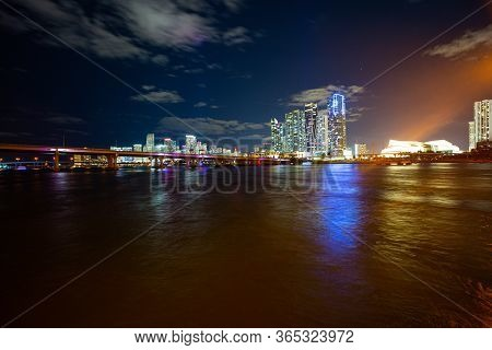 Miami Skyline Panorama After Sunset. Miami City Skyline Panorama At Dusk With Urban Skyscrapers And