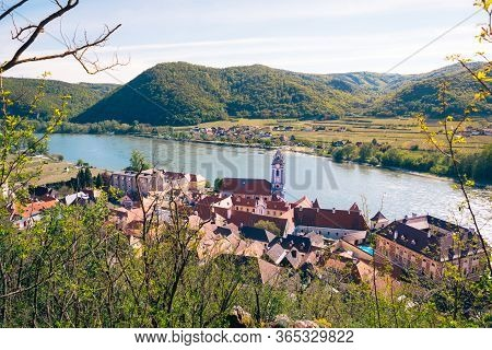 Durnstein Town In The Wachau Valley With Blue And White Tower Of The Abbey Church And River Danube F