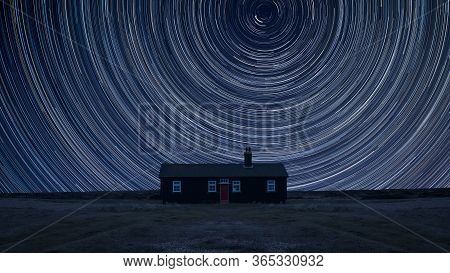 Digital Composite Image Of Star Trails Around Polaris With Stunning Vibrant Landscape Of Remote Deso