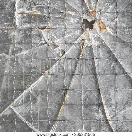 Shattered Reinforced Glass Background. Closeup Of Broken Glass Texture.