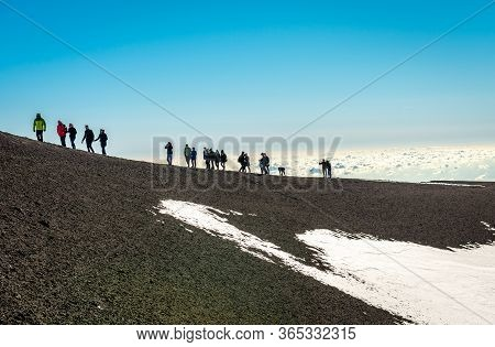 Etna / Italy - December 28 2015: People Hike On Mount Etna, In Sicily.