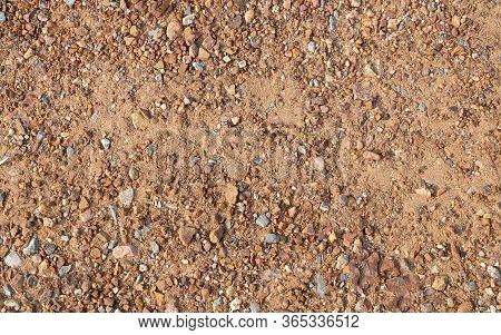 Naturally Small Gravel, Rubble Stone Or Crushed Stone On The Ground.