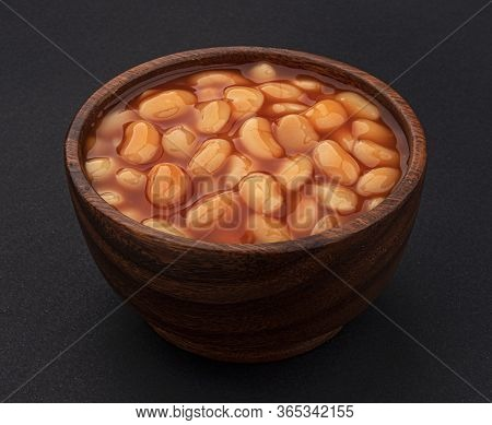 Baked Beans In Tomato Sauce On Black Background