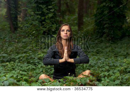 Beautiful girl meditating