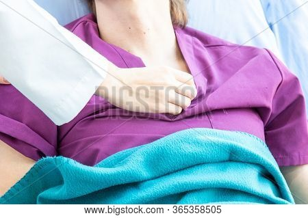 Doctor Use The Stethoscope To Check The Pulse Of The Male Patient Lying On The Bed.