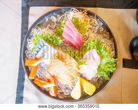 Sashimi Mix Consists Of Salmon, Izumidai, Kanikama, Maguro, Shime-saba And Tamago.