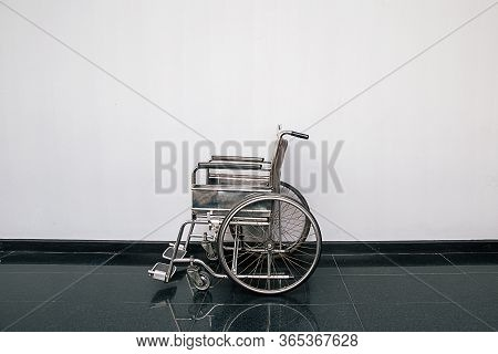 Wheel Chair In The Hospital Corridor. Empty Wheelchair Parked In Patient Rooms At Hospital. Empty Wh