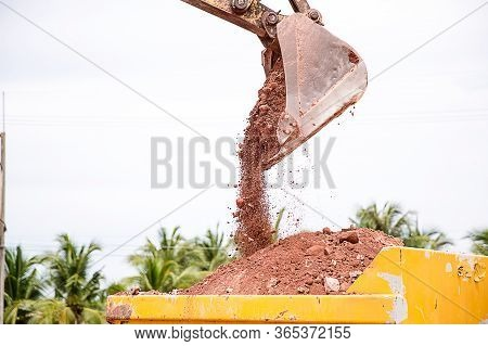 Building Machines: Digger Loading Trucks With Soil. Excavator Loading Sand Into A Dump Truck. Work I