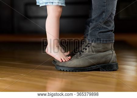 Barefoot A Child Meets Or Escorts His Father To Work. A Girl Stands On Her Fathers Boots. The Depart