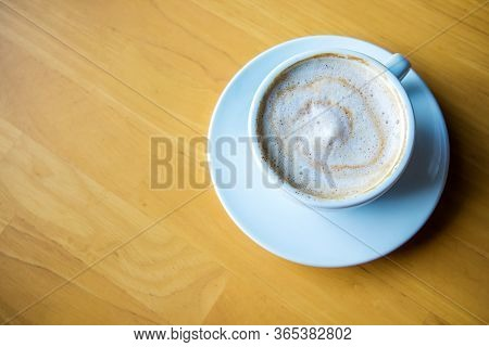 Hot Coffee Cappuccino Cup With Milk Foam On Wood Table Background. Drinken Latte Art Coffee On Woode