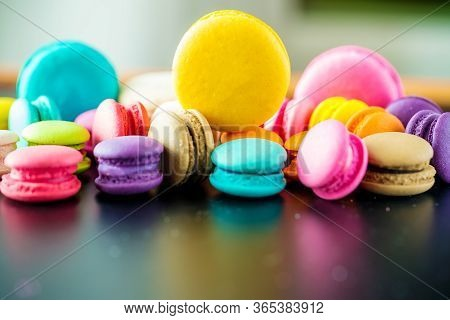 Olorful Macarons Dessert With Vintage Pastel Tones. Colorful French Macarons Background,different Co
