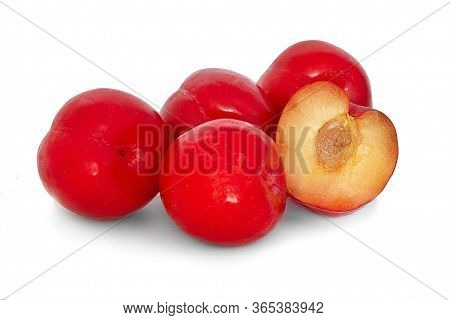 Plums On A Big Background, Isolate. Bright Plums Black Or Red Without Background. Many Ripe And Juic