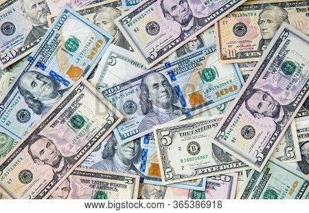 The Many Dollars. Money American Fifty Dollar Bills .pile Of Various Currencies Isolated On White Ba