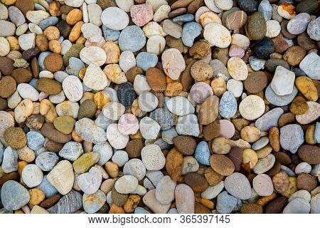 Sea Pebbles. Small Stones Gravel Texture Background.pile Of Pebbles, Thailand.color Stone In Backgro