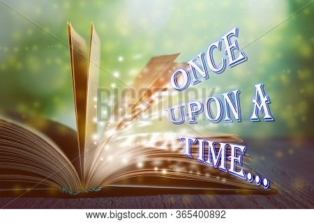 Open Book Of Fairy Tales With Magic Light And Text Once Upon A Time