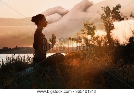 Double Exposure Of Woman Meditating And Hands Reaching Each Other Outdoors At Sunset. Yoga Helping I