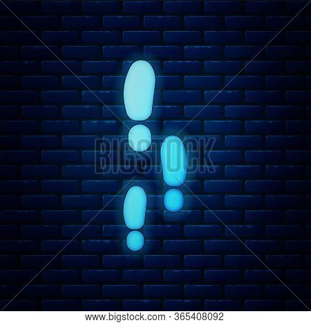 Glowing Neon Footsteps Icon Isolated On Brick Wall Background. Detective Is Investigating. To Follow