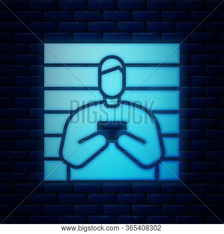 Glowing Neon Suspect Criminal Icon Isolated On Brick Wall Background. The Criminal In Prison, Suspec