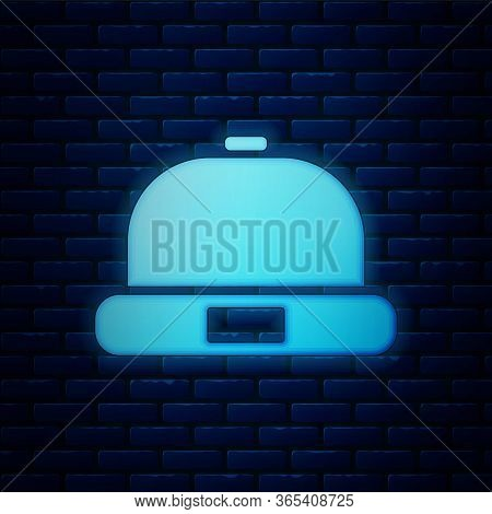 Glowing Neon Beanie Hat Icon Isolated On Brick Wall Background. Vector Illustration