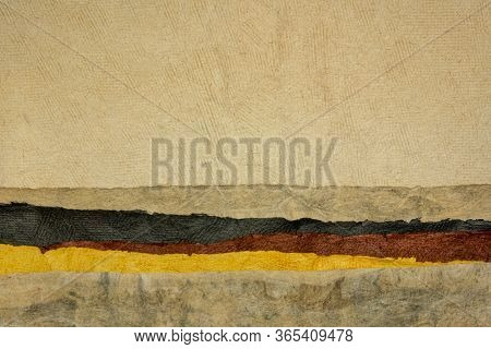 abstract landscape in earth tones created with sheets of textured colorful handmade paper
