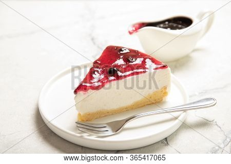 Cheesecake With Jam On The Table. Delicious Homemade Cheesecake