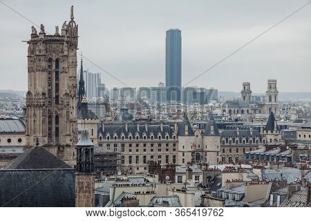 View Of The Parisian Roofs And Palace Of Justice On The Island Of Cite.