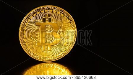 Crypto Currency Golden Bitcoins Isolated On Black Background . Photo Virtual Money.blockchain Techno