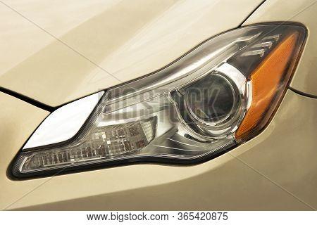 Car Headlights. Luxury Headlights. Part Of A Beige Car