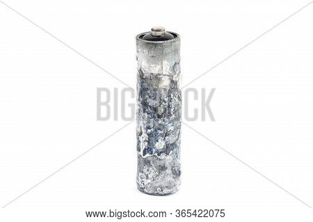 Close-up Of A Heavily Oxidized Unwrapped Aa Battery Isolated On White.