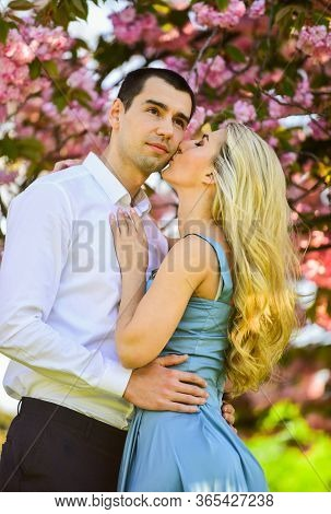 We Love Kissing. Spring Flower Bloom. Man And Woman In Park With Pink Blossoming Cherry. Beauty And