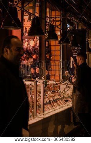 Madrid, Spain - January 26, 2020: Customers At Mas Stand Inside Mercado De San Miguel (
