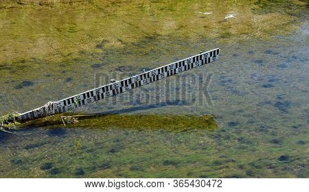 Water Meter Bar On Shallow River In Serbia
