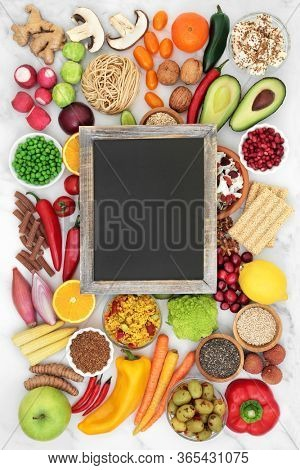 Vegan health food for clean eating concept with foods high in omega 3, protein, vitamins, minerals, anthocyanins, antioxidants, smart carbs & dietary fibre. Immune boosting foods on marble.