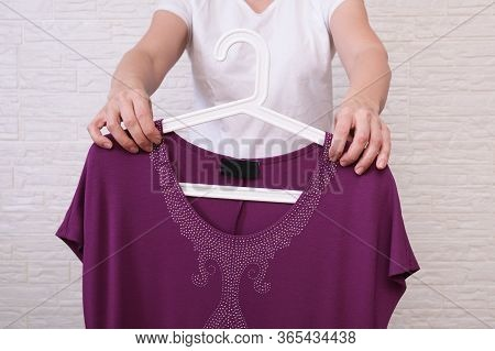 Caucasian Woman Choosing Clothes, She Is Holding A Hanger With Formal Dress, Shopping, Fitting And B