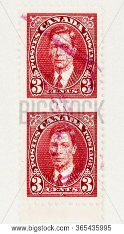 Seattle Washington - May 8, 2020: Close Up Of 1937 Two Red 3 Cent Canadian Stamps  Of King George Vi