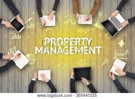 Group of Busy People Working in an Office with PROPERTY MANAGEMENT inscription, succesfull business concept
