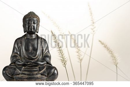 A View Of A Replica Statue Of The Buddha With Fountain Grass In The Background