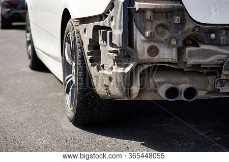Damaged Car After An Accident. Vehicle With Removed Rear Bumper